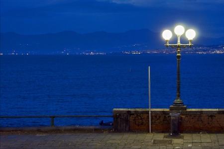 street lamp a bulb in the   sky mediterranean sea naples photo