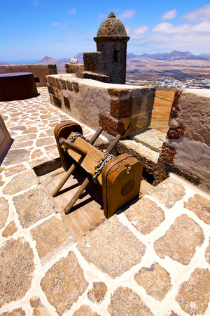 winch house  castillo de las coloradas  lanzarote  spain the old wall castle  sentry tower and door  in teguise