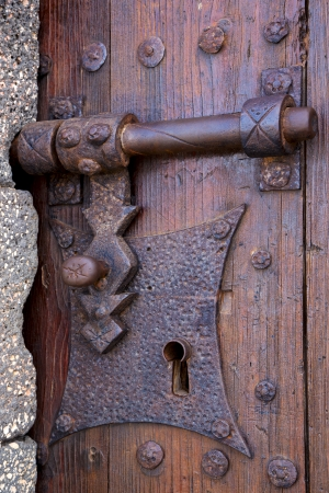 castle lock spain knocker lanzarote abstract door wood in the red brown   photo