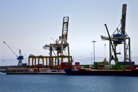 spain crane and harbor pier boat in the blue sky   arrecife teguise lanzarote  photo