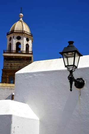 teguise   lanzarote  spain the old wall terrace church bell tower in arrecife  photo
