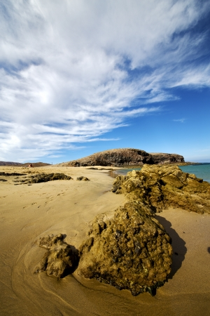 sky cloud beach  water  coastline and summer in lanzarote spain photo