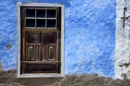 brown wood   window in a blue wall arrecife lanzarote spain photo