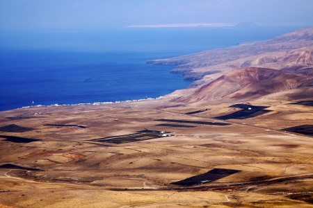 view from the top in lanzarote spain africa and house field coastline  photo