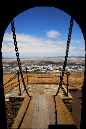 drawbridge  lanzarote  spain the old wall castle  sentry tower and door  in teguise arrecife  photo