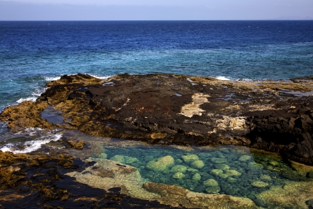 lagoon sky cloud beach  water  coastline and summer in lanzarote spain photo