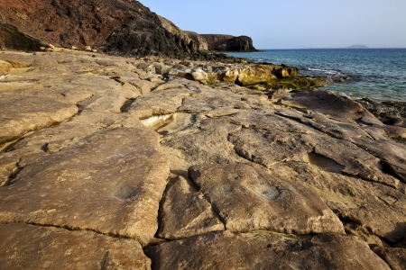 rock stone sky cloud beach  water  coastline and summer in lanzarote spain photo
