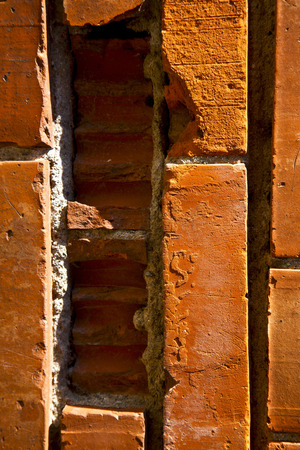 old wall  brick in the   centre   of cairate varese italy photo