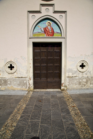 brass brown knocker and wood  door in a church abbiate varese italy photo