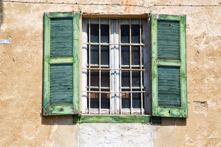lonate ceppino varese italy abstract  window   green  wood venetian blind in the concrete Banco de Imagens