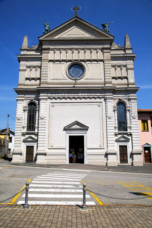 church  castronno  italy the old wall terrace  window  clock and bell tower photo