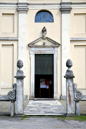 italy  sumirago church  varese  the old door entrance and mosaic sunny daY