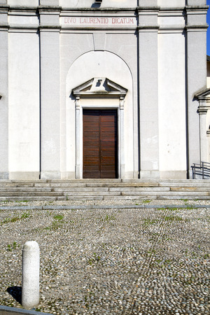 italy  sumirago church  varese  the old door entrance and mosaic sunny daY photo