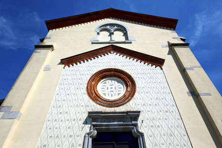 crugnola italy   church  varese  the old door entrance and abstract mosaic sunny daY rose window photo