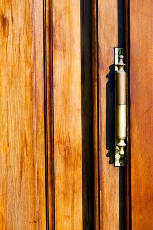 castellanza blur lombardy   abstract   rusty brass brown knocker in a  door curch  closed wood italy   cross photo