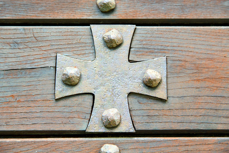 cross lombardy   arsago seprio abstract   rusty brass brown knocker in a  door curch  closed wood italy photo
