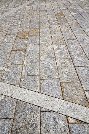 curch: brick in  legnano  street lombardy italy  varese abstract   pavement of a curch and marble