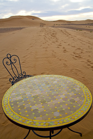 mirage: table and seat in  desert sahara morocco    africa yellow sand