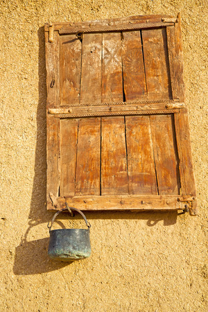 rusty background: window in morocco africa and old construction wal brick historical Stock Photo
