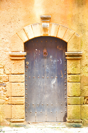 historical in  antique building door morocco style africa   wood and metal rusty photo