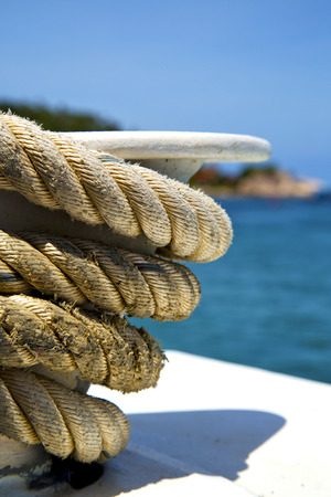 ship anchor: asia in the  kho tao bay isle white  ship   rope  and south china sea anchor Stock Photo