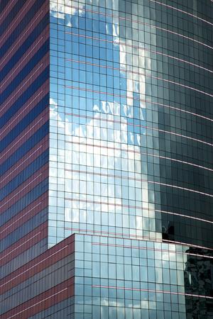 Asia Bangkok  Thailand reflex of some blue skyscraper in a window    the center photo