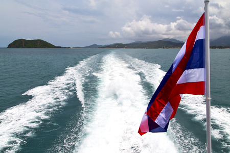 asia myanmar kho samui bay isle waving flag    in thailand and south china sea photo