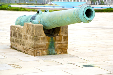 bombard: bronze cannon in africa morocco  green  and the old pavement