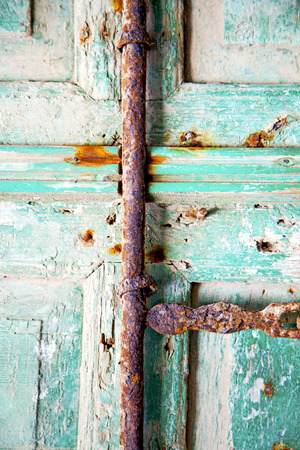 Morocco in africa the old wood  facade home and rusty safe padlock photo