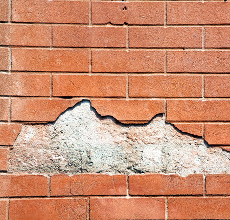 curch: lonate pozzolo lombardy italy  varese abstract   wall of a curch broke brike pattern Stock Photo