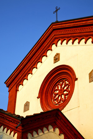 rose window: italy  lombardy     in  the barza     old   church   closed brick tower   wall rose   window tile Stock Photo