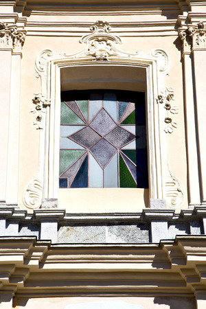 rose window: italy  lombardy     in  the somma lombardo  old   church   closed brick tower   wall rose   window tile