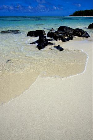 du: beach and parachute  in ile du cerfs mauritius