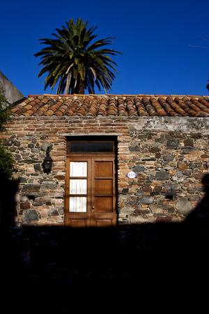 colonia del sacramento: brown wood old door  in the centre of colonia del sacramento uruguay