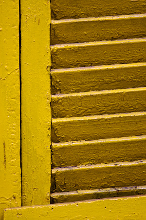 la boca: yellow venetian blind in buenos aires la boca Stock Photo