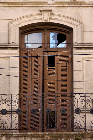 pigeon holes: old metal little terrace brown broke venetian blind  in the centre of buenos aires la boca argentina Stock Photo