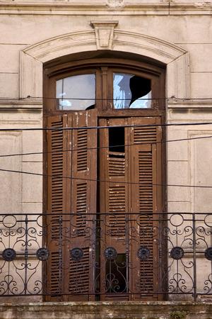 la boca: old metal little terrace brown broke venetian blind  in the centre of buenos aires la boca argentina Stock Photo