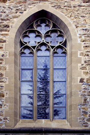 colored window: the colored rose window and a tree  in the church in  lichtenstein vaduz Stock Photo