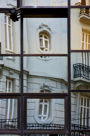 distort: reflex of some palace in a house  window of the centre  buenos aires argentina