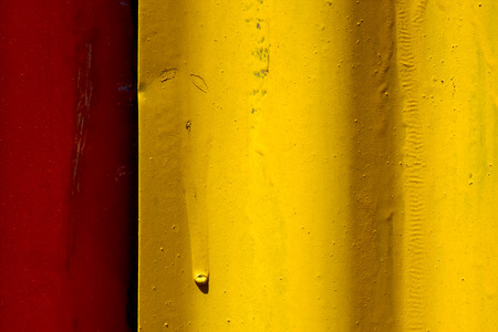 la boca: abstract colored red and yellow iron metal sheet in la boca buenos aires argentina