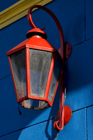 la boca: a red street lamp  and a blue yellow  wall in la boca buenos aires argentina Stock Photo
