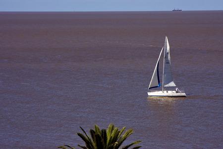 mercantile: ship and a mercantile in the  river rio de la plata near colonia del sacramento uruguay