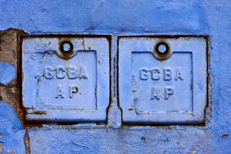 la boca: two metal box and a blue broken wall in la boca buenos aires argentina