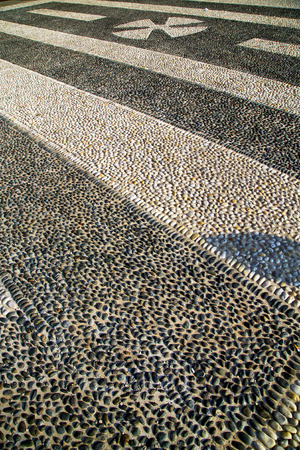 in the castano primo  street lombardy italy  varese abstract   pavement of a curch and marble photo