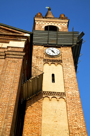 rose window: italy  lombardy     in  the parabiago  old   church   closed brick tower   wall rose   window tile