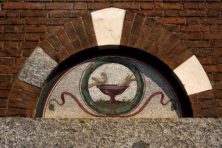 architrave: the pigeon over the door in san babila in milan