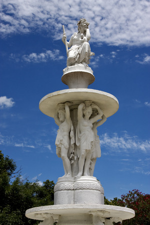kneel down: marble statue of a women and some man in san nicolas argentina Stock Photo