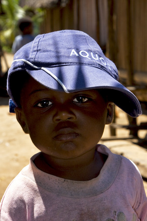 bambino: portraif of a little chilld male in the isle of madagascar nosy be Editorial