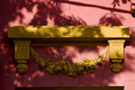 la boca: yellow marble top of door and a pink wall in la boca buenos aires argentina