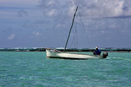 cocos: boat in deus cocos mauritius